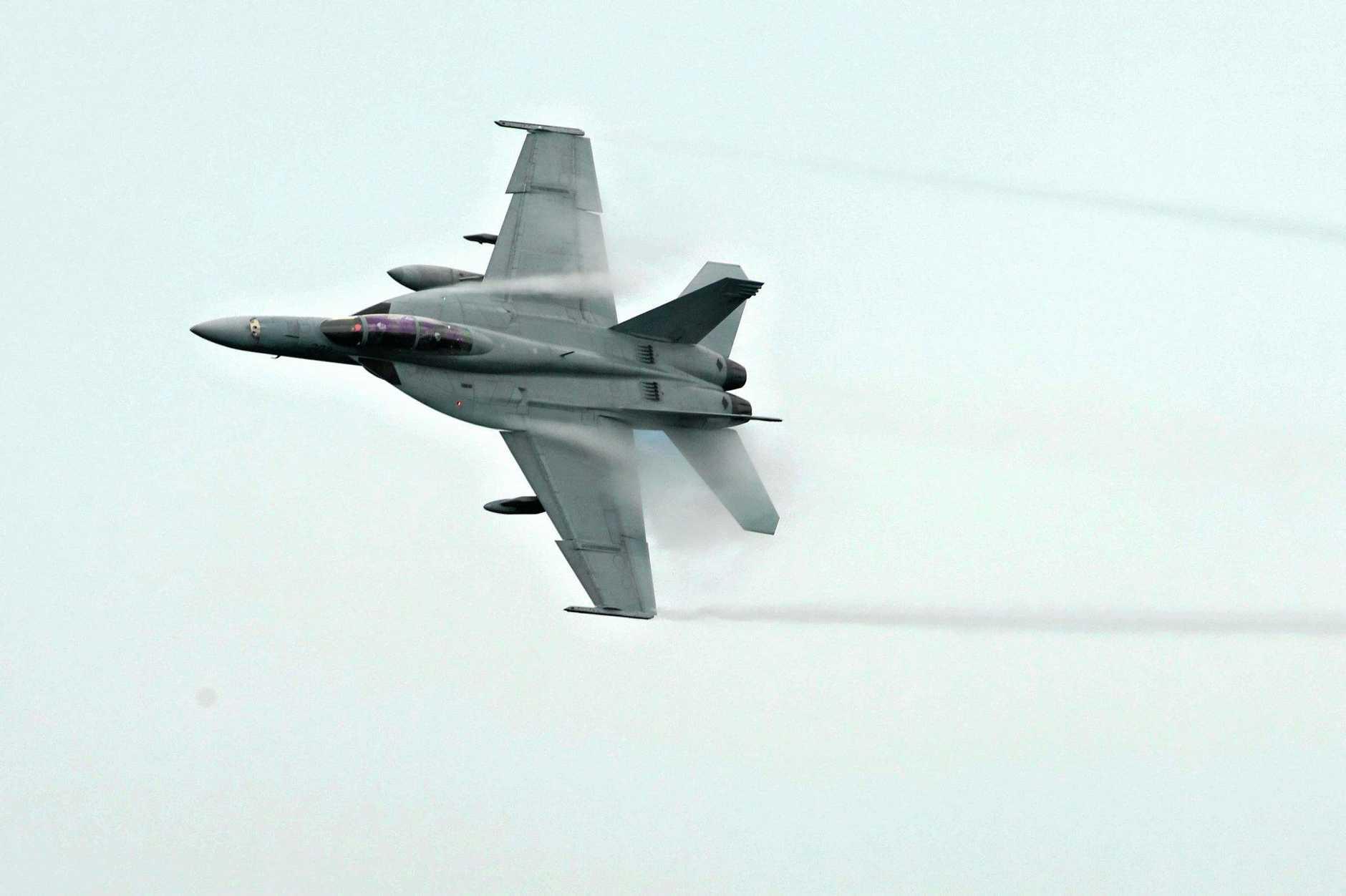 SPEED DEMON: A F/A-18F Superhornet will do a flypast on Sunday at Queensland Raceway.