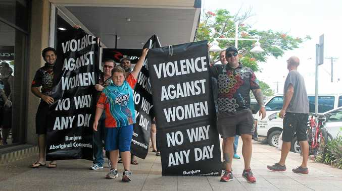 STOP THE VIOLENCE: Leading last year's White Ribbon Day walk in Ballina were (from left) Jarred Roberts and Lukas Williams Jnr and Lukas Williams Snr. Photo Graham Broadhead / Ballina Shire Advocate
