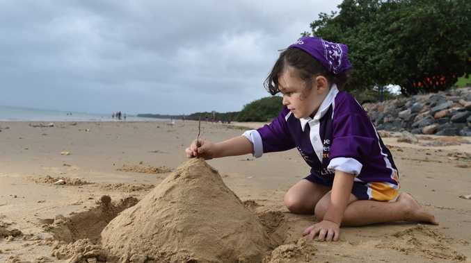 SANDY DREAMS: Monique Bailey, aged seven, hopes a beach full of sandcastles is built at Scarness Beach on Saturday.