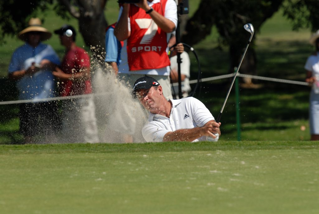 2006 PGA Golf Championship at Hyatt Coolum , Day 4. Peter Lonard chips out of the bunker.