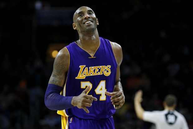 Los Angeles Lakers' Kobe Bryant smiles as he jogs to the bench during the first half of an NBA basketball game against the Philadelphia 76ers. Photo: AP Photo/Matt Slocum.