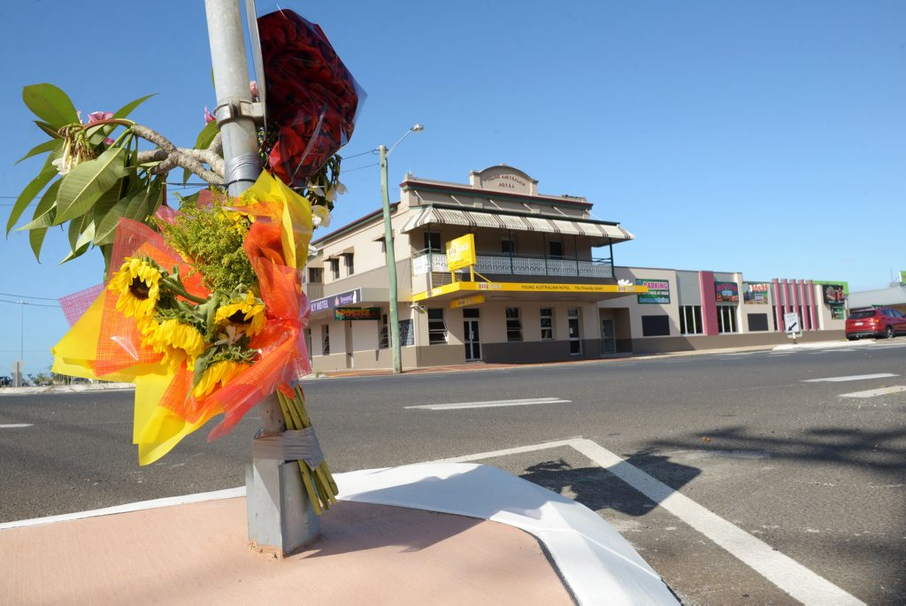 ANOTHER FATALITY: Tributes mark the scene where a man lost his life on Friday afternoon after being run over in a hit and run incident outside Harry's Mowers in North Bundaberg. Photo: Max Fleet / NewsMail