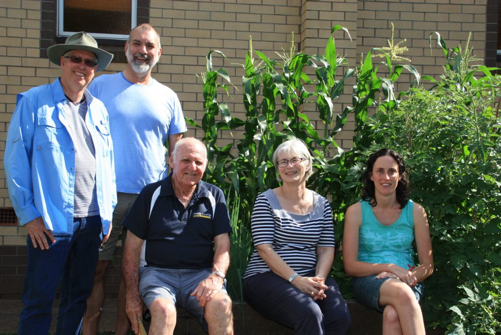 GROWING SUPPORT: Pastor Walter Jones (left), Andrew Schache, George McKinnon, Marilyn Schache and Lisa Seymour are part of the Nede community garden concept flourishing at St John's Presbyterian Church. Photo Megan Masters / The Chronicle