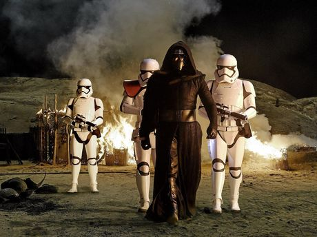 Adam Driver and Stormtroopers in a scene from the movie Star Wars: The Force Awakens. Supplied by Disney. Photo by David James.