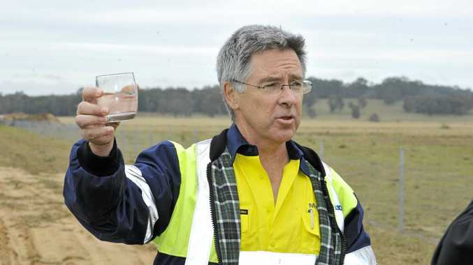REMEMBER THE GOOD TIMES: Managing Director of Metgasco Peter Henderson drinking produced water from CSG exploration in 2012. Photo Cathy Adams / The Northern Star