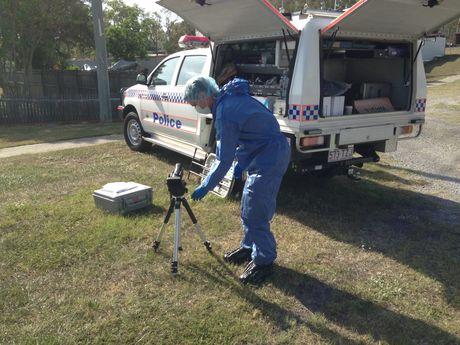 Forensic scientists prepare to examine the crime scene.