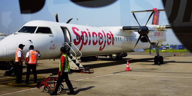 The SpiceJet plane carrying 49 passengers and four crew members hit the boars on the runway at Dumna airport at Jabalpur, India. Photo / AP