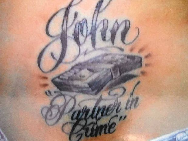 REMINDER: John Cole's tattoo (LEFT) and partner in crime Shailee Jane Kingston's matching ink.