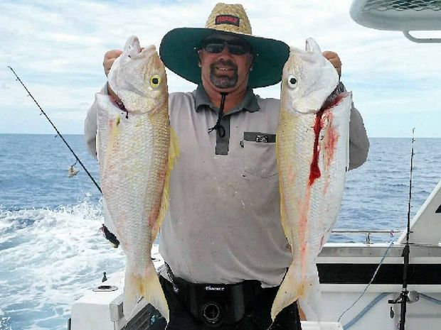 GOOD FISH: Steve Mau with two large mouth nannygai caught during the club's trip.