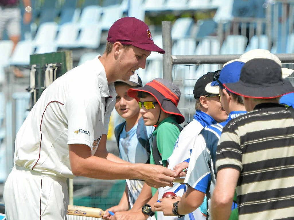 LUCKY FANS: Billy Stanlake signing autographs during a break in day two of the Sheffield Shield match at Harrup Park.