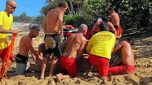 Mick Fanning was part of a rescue team that got unconscious surfer Evan Geiselman out of the water at Hawaii's pipeline break.