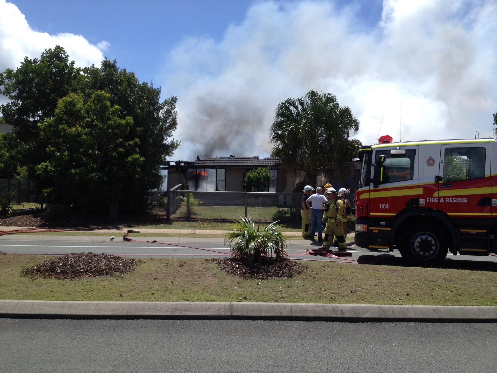 Fire crews battle a house fire at Twin Waters.