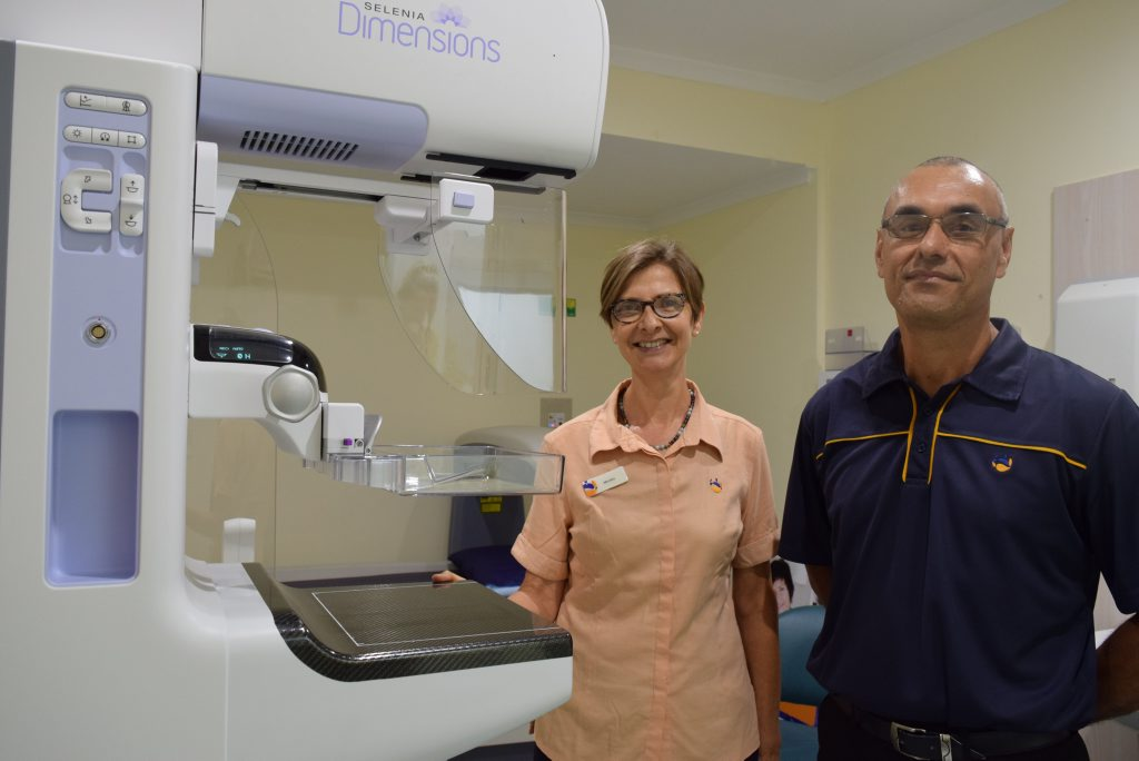 Gladstone Mater Hospital chief radiographer Julian Simpson pictured with senior mammographer Monica with their new 3D mammography system. Photo Tegan Annett / The Observer