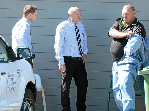 CRIME SCENE: Kenneth John Beattie, 51, (above far right) is accused of murdering his flatmate Mal Wood, 51, (below) last year at the house they shared in Scottsdale St, Raceview.