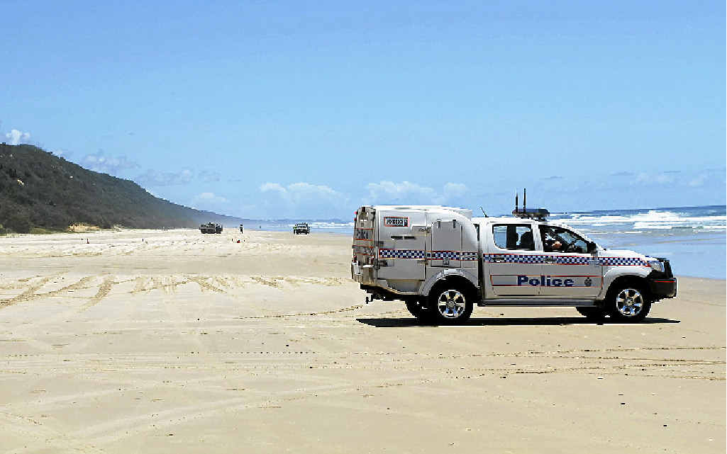 NO ENTRY: Police block off Teewah Beach yesterday after a suspicious device was found, later identified as a marine marker.