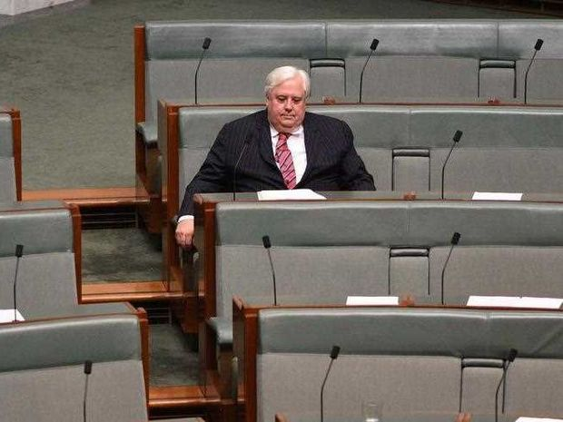 Palmer United Party leader Clive Palmer waits to speak on a matter of public importance at Parliament House in Canberra on Tuesday, Dec. 1, 2015.