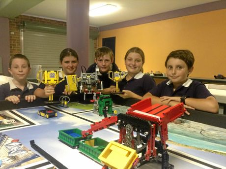 The iCode22 team from Skennars Head with their trophies and robot. From left: Ben Masterson,10, Bridie McCowan, 11, Reuben Adlington, 11, Taya Kelly, 11 and Jordan Nixon, 11.