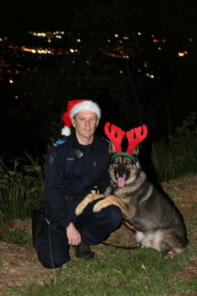 Rockhampton police dog Jabba and partner Sergeant Moore wish everyone a 'safe furry Christmas'.