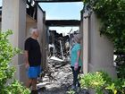 Twin Waters resident Rob Smith and his daughter Hayley Barry-Smith take stock of fire destruction at at Mr Smith's Baywater Dr home. Photo Stuart Cumming/ Sunshine Coast Daily