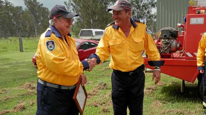 SHANNONBROOK Rural Fire Service Captain Craig Yates congratulates his Deputy, Vin Johnson, on life membership.
