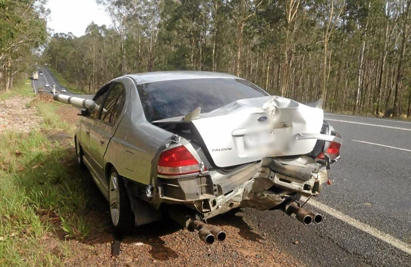 NO WORRIES: This car was pulled over by police on the Pacific Highway near Grafton this morning, having crashed into a pole the night before.