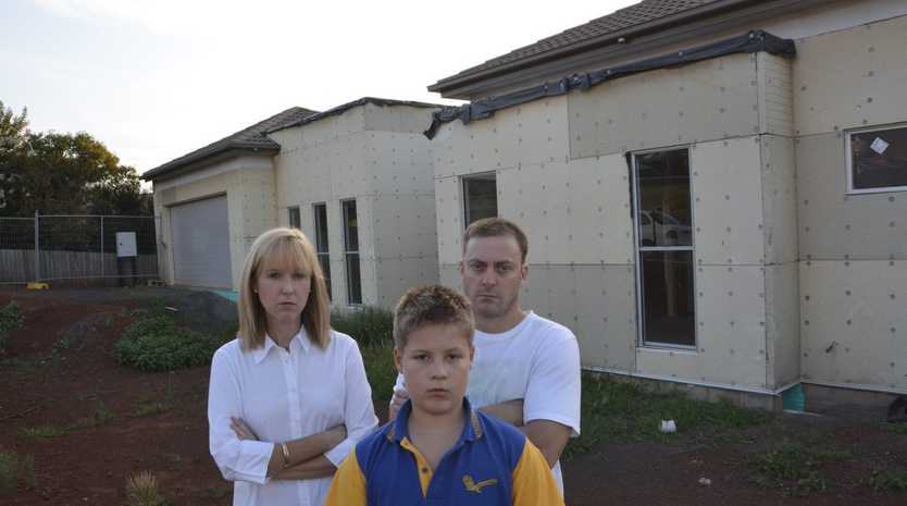 The Barton family (from left) Priscilla, Jaiden and Robert Barton outside their unbuilt Rangeville home.