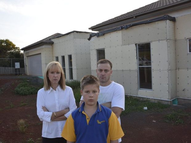 The Barton family (from left) Priscilla, Jaiden and Robert Barton outside their unbuilt Rangeville home.