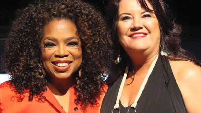 STAR POWER: Oprah Winfrey with Yeppoon's Karla McPhail.