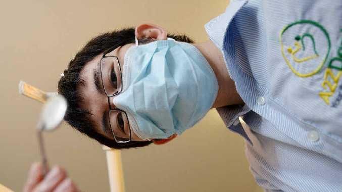 OPEN WIDE: Dr Abraham Zacharia's colleague, dentist Dr Ho-Chieh.