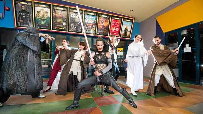 READY FOR ACTION: Star Wars fans at Birch Carroll Coyle Coffs Harbour are Aaron Anderson (Emperor Palpatine), Allison Lawdon (Leia), Triss Baher (Jedi), Jip Panosot (Sith Lord), Joel Godfrey (Hans Solo), Rebecca Riches (Leia) and Jay Anderson (Obi Wan Kenobi).