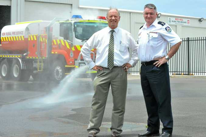 Welcoming funding to Rural Fire Service stations are Coffs Harbour MP Andrew Fraser and RFS superintendent Sean McArdle.