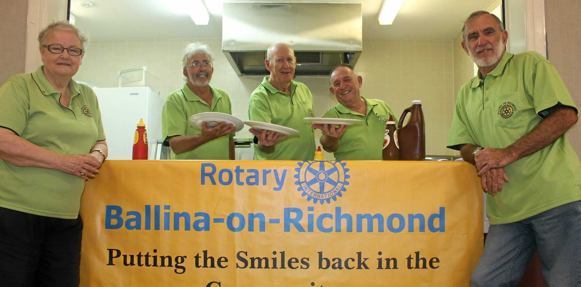 DINNER ON US: Rotary Club of Ballina-on-Richmond members Lee Soutar, Shane Cullinane and Wayne Crawford help prepare for the club's first free dinner service for those doing it tough.