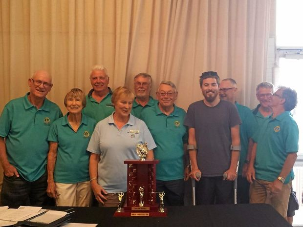 Shark attack victim Mathew Lee with members of the Lennox Head Lions Club after the John Mitchell Annual Charity Golf Day.