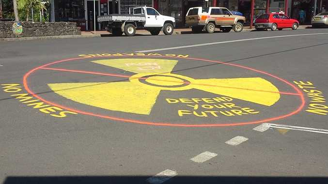 An anti-nuclear message was painted on Nimbin's main street overnight. Photo: Contributed