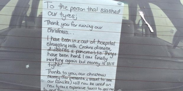 The note attached to vehicle after the tyres were slashed.