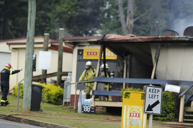 Fire officers on site respond to the Kandanga Hotel fire last weekend.