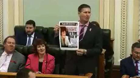 Oppostion leader Lawrence Springborg holds up a QT in parliament. Photo: Contributed