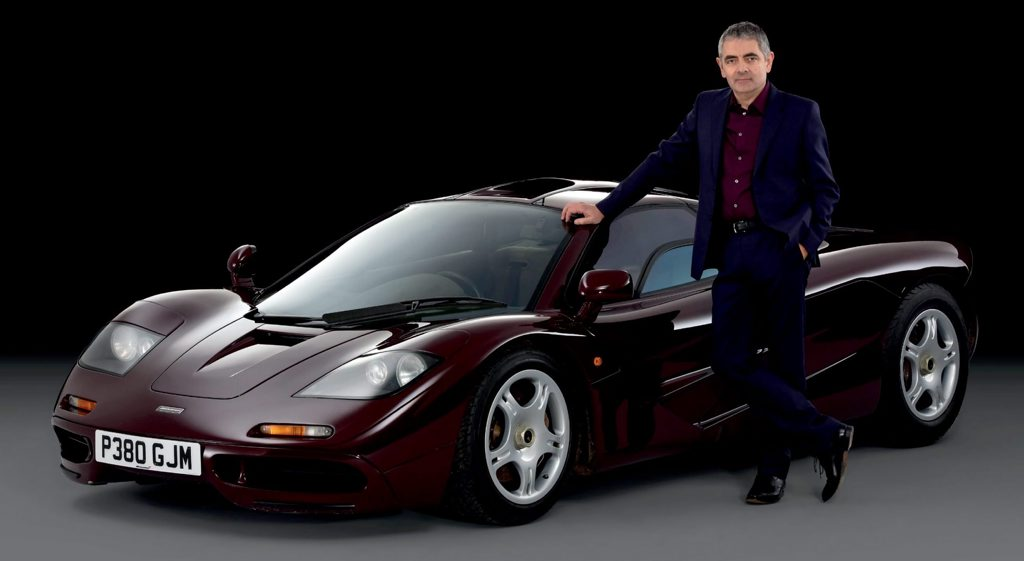 Mr Bean actor Rowan Atkinson with the McLaren F1 Supercar he has recently sold for an $11.1 million profit