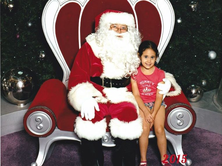 Lily Brown's photo with Santa at Grand Central was paid for by a stranger who was spreading Christmas cheer.