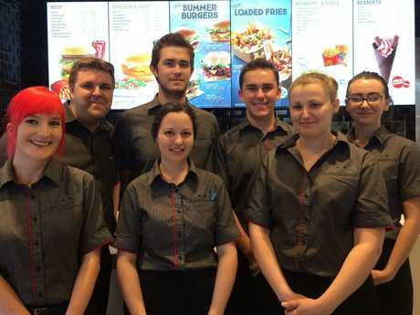 NEW MACCAS: Serving from 9am today are McDonald's East Toowoomba staff (from left) Melissa Ireland, general manager Nathan Whitley, Scott Laman, Shannon Butler, Brayden Taylor, Sheree Kilby and Hannah Warner. Photo Charlotte Lam / The Chronicle