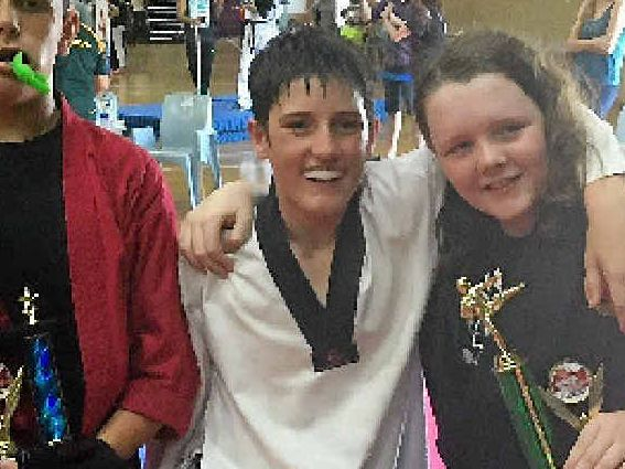 SUCCESS: Thomas Gosney (centre) performed well at the ISKA National Championships.