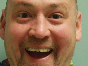 Man arrested for magic mushrooms has euphoric mugshot