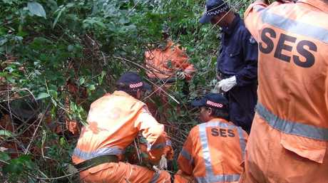 Police and SES volunteers search forest at Brooloo, near Imbil, following new leads in the case of missing women, Celena Bridge and Sabrina Ann Glassop. Photo: Nathan Woulfe