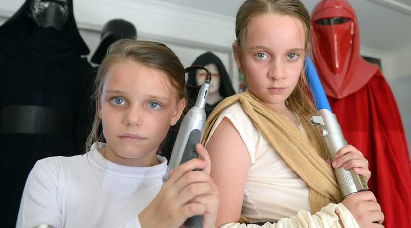 Sophie and Elise Duxbury are glad their dad Warren Duxbury is a huge Star Wars fan. He worked on the Attack of the Clones movie in Sydney and advocates the importance of girls in big ticket movies like Star Wars.