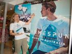EMERALD BEACH ON DISPLAY: Winning photographer Liz McGinnes with the T-shirt featuring her image.