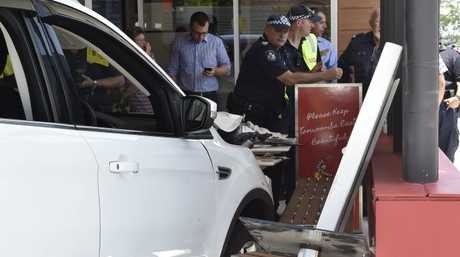 A car has crashed into a section of the new McDonald's Restaurant on Herries Street injuring two children.
