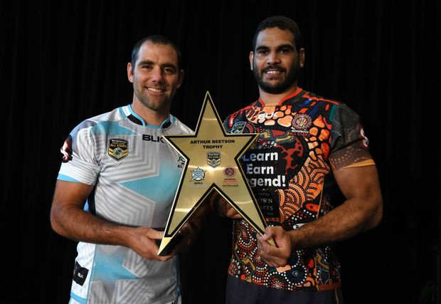 Captain of the World All Stars Cameron Smith (left) and Greg Inglis of the Indigenous All Stars pose for a photo with the Arthur Beetson trophy after both teams were announced in Brisbane. The All Stars game will be played at Suncorp Stadium on February 13, 2016. Photo: AAP Image/Dan Peled.