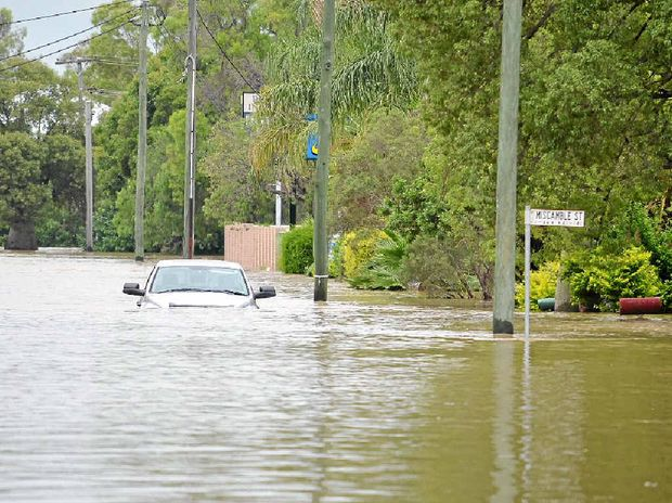 CONTRIBUTING FACTOR: Roma's Northern Road became a 'Northern River' during the height of the flood, which scientists have found were made worse by warmer ocean temperatures.