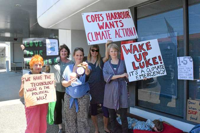 SMALL STEPS: The Coffs Coast Climate Action Group protested in front of Luke Hartsuyker's office for more climate change policy.