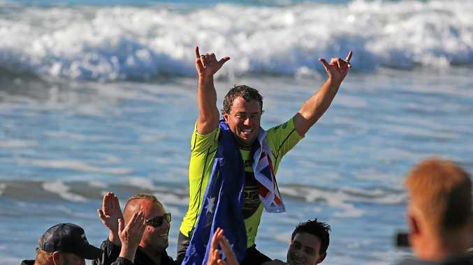 Emerald Beach longboard surfer Paul Scholten celebrates a hometown victory at the bcu Australian Surf Festival.